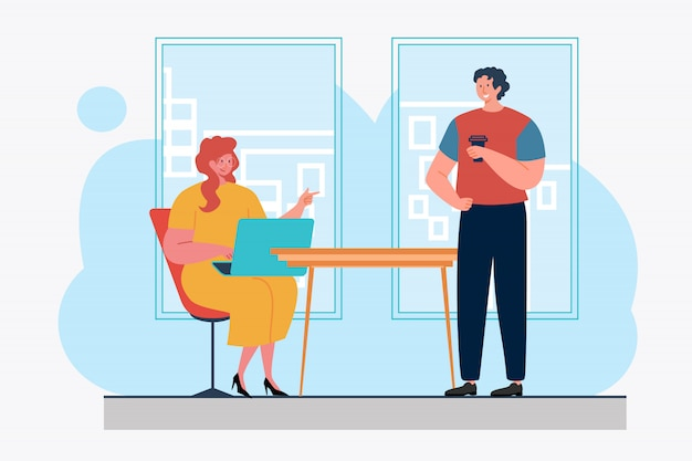 Collègues utilisant un ordinateur portable et discutant