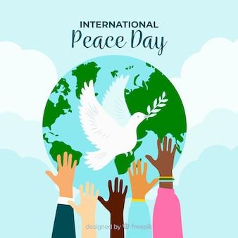 Colombe devant le monde pour la journée de la paix