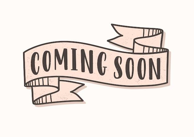 Coming soon lettrage ou inscription écrite sur ruban ou ruban adhésif
