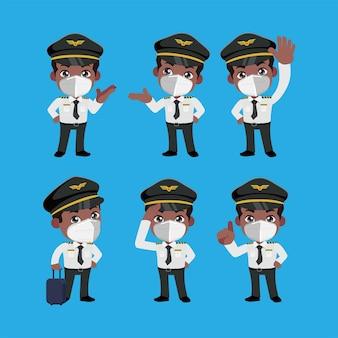 Le commandant d'équipage portant un masque facial protège le coronavirus covid19 dans différentes poses