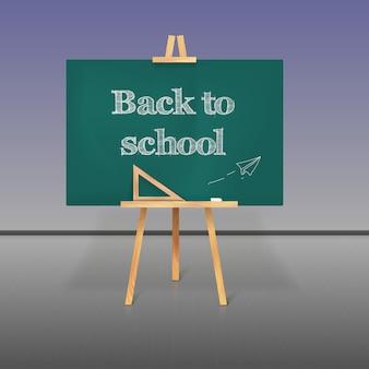 Commission scolaire verte à la craie sur un trépied