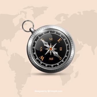 Compas noir sur l'arrière plan de la carte du monde