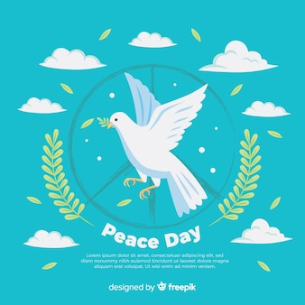 Composition de la journée de la paix dessinée à la main avec une belle colombe