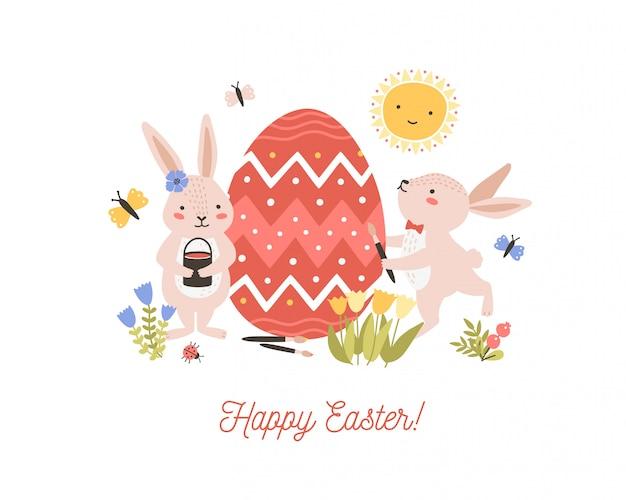 Composition décorative festive avec une paire d'adorables adorables lapins ou lapins décorant un œuf géant et un souhait de joyeuses pâques. illustration de dessin animé plat pour la célébration de vacances religieuses de printemps.