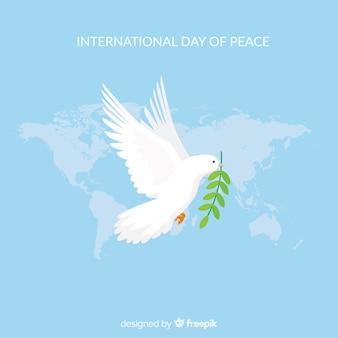 Composition du jour de la paix avec colombe blanche et plate