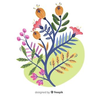 Composition avec des fleurs en fleurs et des branches