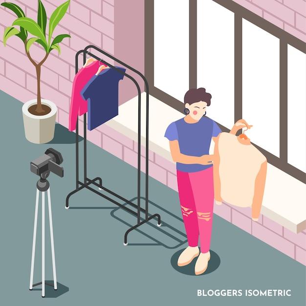 Composition isométrique avec une blogueuse de mode féminine tenant un pull et filmant une vidéo avec une caméra 3d