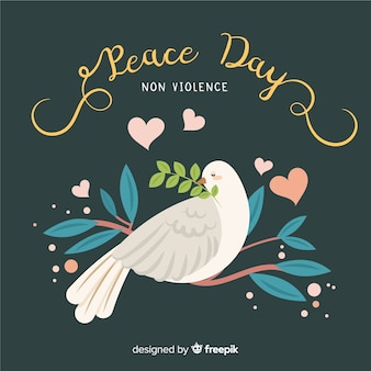 Composition de jour de paix avec colombe blanche et plate
