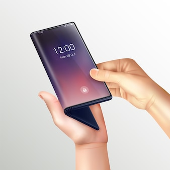 Composition réaliste de smartphone pliable avec des mains humaines tenant un téléphone pliant près de l'écran sur un dégradé