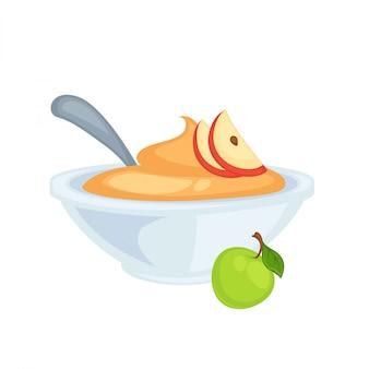 Compote de pommes sucrée dans un bol profond avec une cuillère