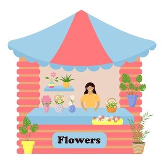 Comptoir de marché vendant des fleurs dans des vases et des plantes d'intérieur en pots