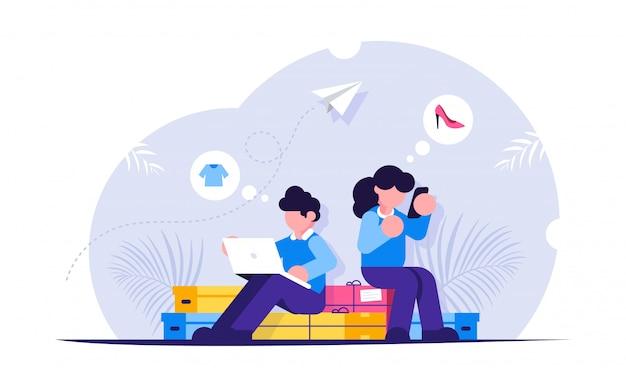Concept d'achat en ligne. homme et femme achètent en ligne à l'aide d'un ordinateur portable et d'un téléphone mobile. les gens sont assis sur des boîtes à provisions.