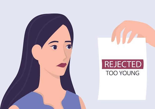 Concept d'âgisme de recrutement. le spécialiste des ressources humaines rejette la jeune femme cv. problème d'injustice et d'emploi des jeunes adultes. le service des ressources humaines n'embauche pas de personnes âgées de 20 ans.