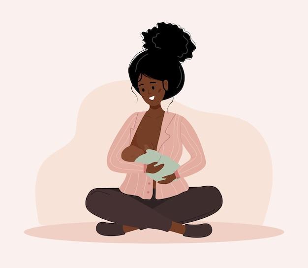 Concept d'allaitement. mère africaine allaitant bébé nouveau-né.