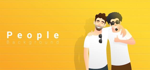 Concept d'amitié avec deux jeunes hommes s'amusant et debout sur jaune