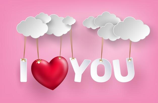 Concept d'amour accroché sur fond de ciel rose