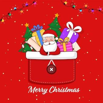 Concept de célébration de joyeux noël avec le père noël mignon, les coffrets cadeaux, la canne en bonbon et l'arbre de noël dans le patch de poche sur fond rouge.