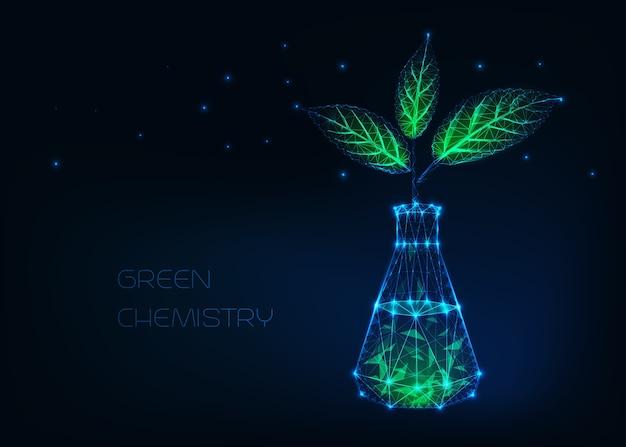 Concept de chimie verte avec bécher chimique incandescent et plante aux feuilles vertes