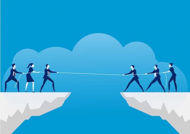 Concept de conflit. hommes d'affaires tirant la corde au-dessus d'un précipice. rivalité et concurrence entre entreprises