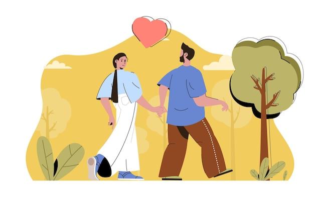 Concept de couple d'amour heureux couple d'amoureux marchant dans le parc et se tenant la main