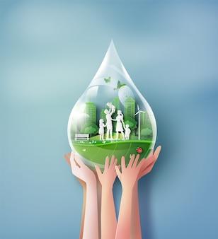 Concept d'écologie et d'environnement avec la famille et les mains. style d'artisanat en papier.