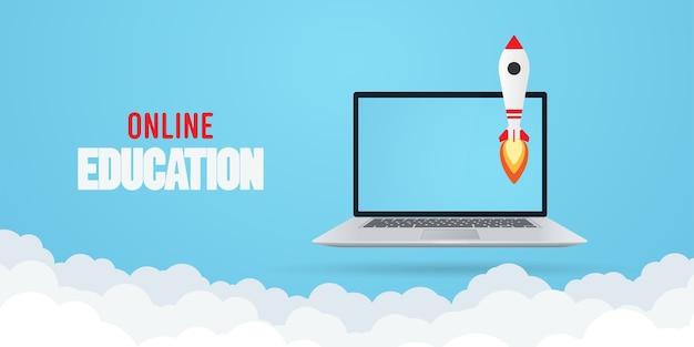 Concept d'éducation en ligne. ordinateur portable avec fusée.