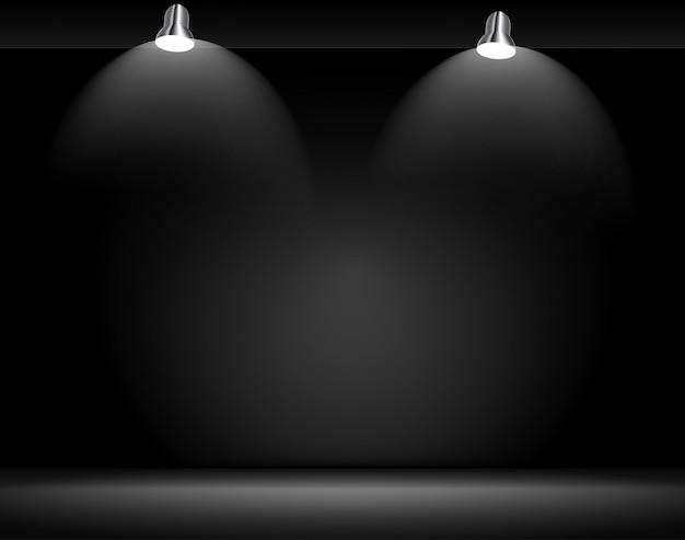 Concept d'exposition. projecteurs et mur vide noir