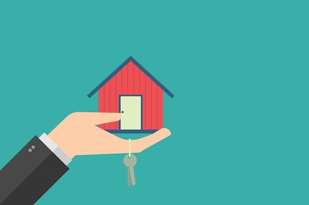 Concept de finance d'entreprise, main tenant la maison dans la paume et la clé. design plat