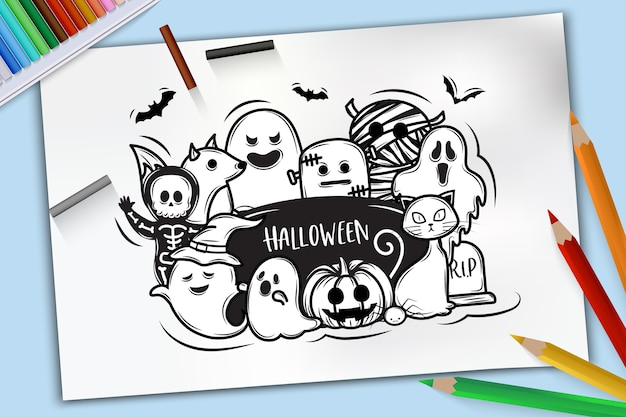 Concept d'halloween, dessiné à la main des fantômes d'halloween sur papier à croquis avec des crayons de couleur sur fond bleu
