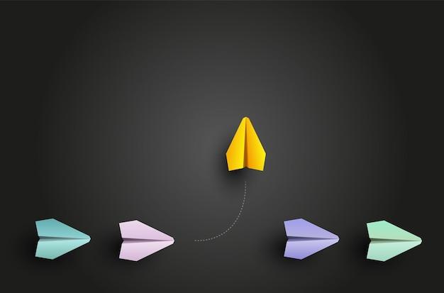 Concept d'individualité un avion en papier jaune leader individuel et unique vole sur le côté illustration vectorielle