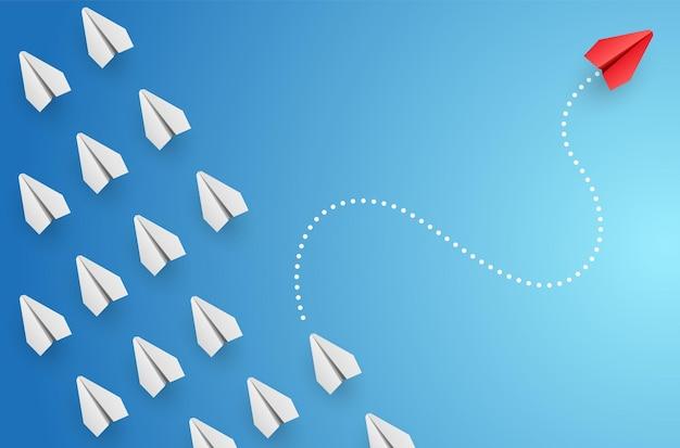 Concept d'individualité et avion en papier rouge leader unique vole vers l'illustration latérale