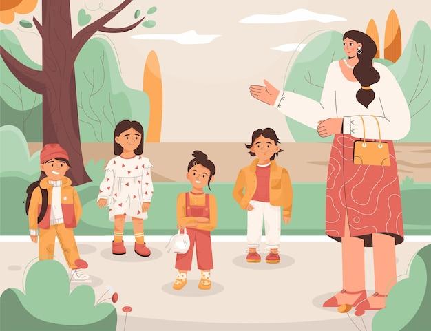 Concept de jardin d'enfants petits garçons et filles marchant avec l'enseignant