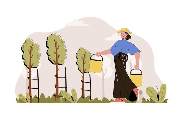 Concept de jardinage agricultrice tenant des seaux et prenant soin des semis d'arbres