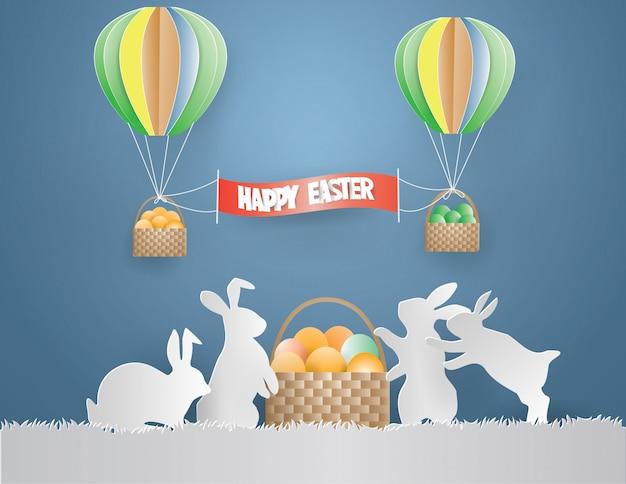 Concept de jour de pâques avec oeufs de lapin de la famille dans le panier