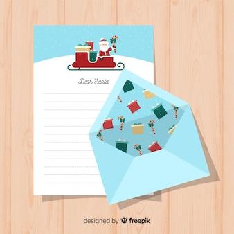 Concept de lettre et enveloppe de noël dans un style plat