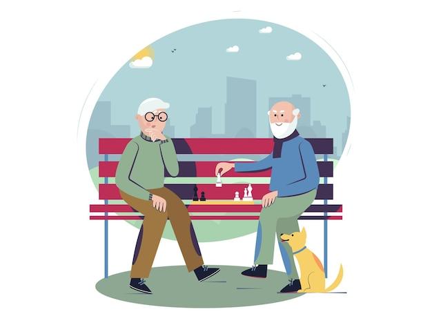 Concept de mode de vie actif social senior hommes seniors jouant aux échecs sur le banc dans le parc