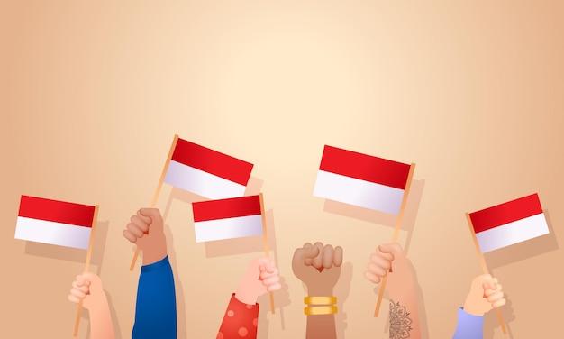Concept de nationalité indonésienne mains tenant la célébration du jour de l'indépendance du drapeau indonésien