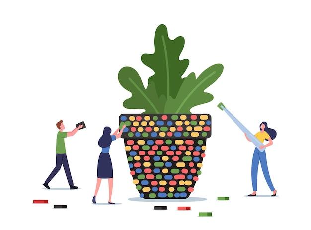 Concept de passe-temps créatif. de minuscules personnages masculins et féminins décorent un pot de fleurs avec des pièces en céramique colorées, installent une énorme mosaïque à l'aide d'une pince à épiler