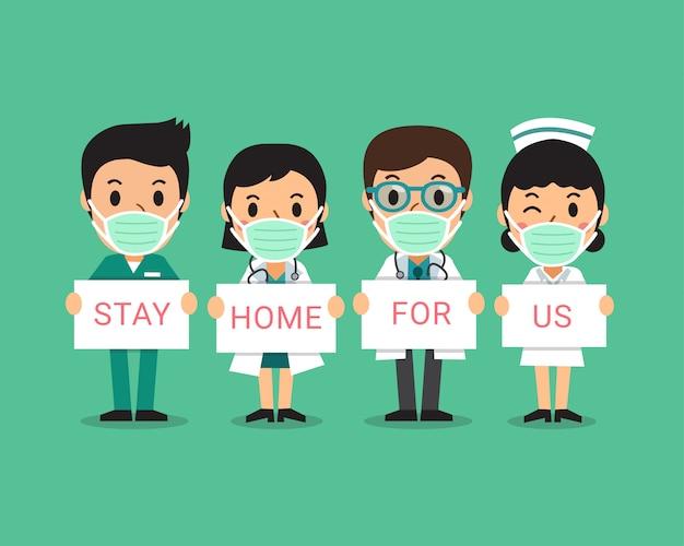 Concept de protection contre le virus covid-19 médecins et infirmières portant des masques protecteurs avec des signes de rester à la maison pour nous