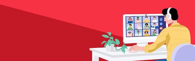 Concept de réunion virtuelle, un jeune homme ayant une vidéoconférence avec ses collègues à la maison.