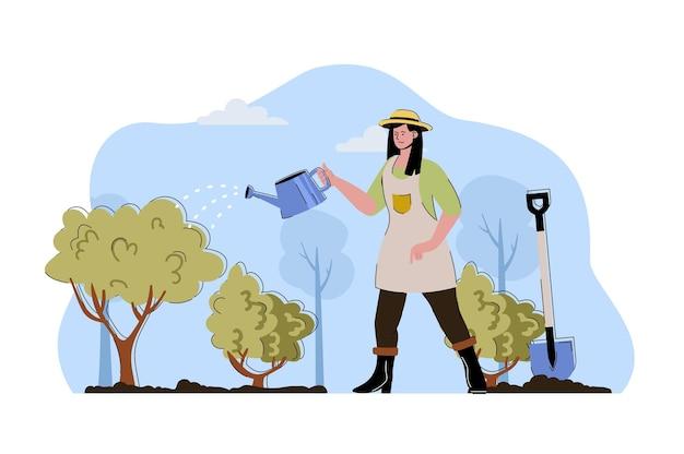 Concept de soins des cultures agricultrice arrosant les plantes et les buissons au jardin