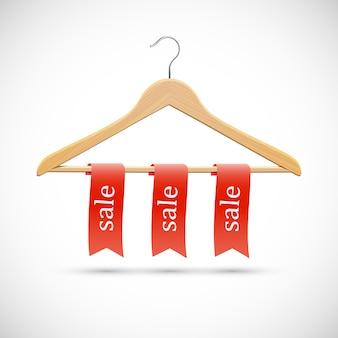 Concept de vente - cintres en bois avec rubans rouges