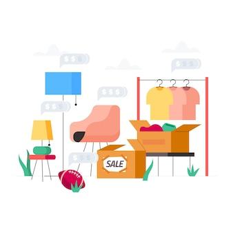Concept de vente de garage avec des vêtements