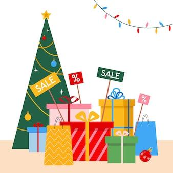 Concept de vente et de remise de noël et du nouvel an cadeaux dans des boîtes près de l'arbre de noël