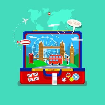 Concept de voyage ou d'étude de l'anglais. drapeau anglais avec points de repère dans une valise ouverte. conception plate