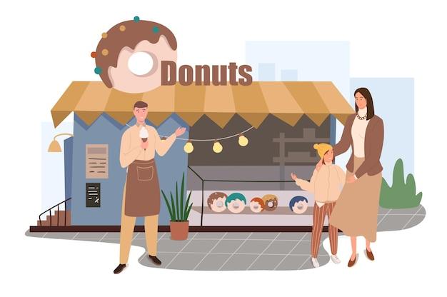 Concept web de construction de boutique de beignets. mère et fille achetant des desserts frais au magasin. le chef pâtissier vend ses produits