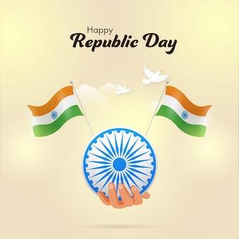 Conception d'affiche de célébration de la fête de la république heureuse avec la main tenant la roue d'ashoka