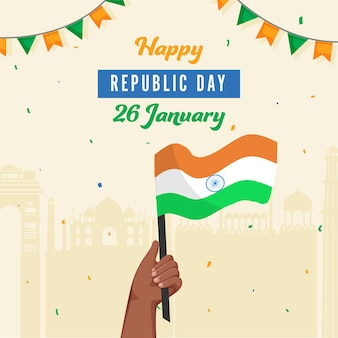 Conception d'affiche de la fête de la république avec la main tenant le drapeau indien