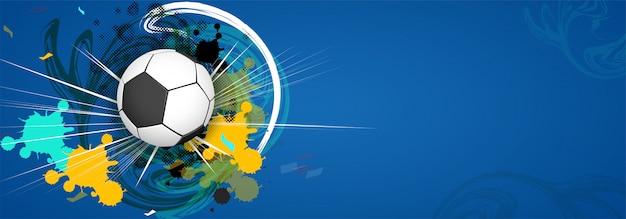 Conception de bannière web avec un football brillant sur fond grungy coloré.