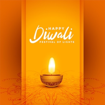 Conception de carte orange décorative traditionnelle du festival joyeux diwali